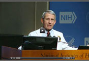Screen capture of video of Dr Tony Fauci speaking at a podium