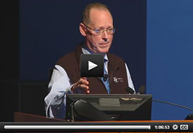Screen capture of webcast shows Dr Paul Farmer speaking at a podium
