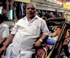 Overweight Indian man in busy street