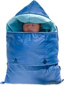 Sleeping infant swaddled in thick blue sleeping bag-like infant warmer