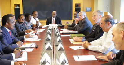 African delegation and NIH leadership seated around a large conference table