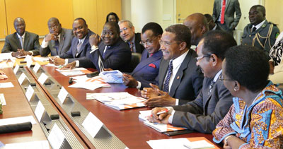 Large delegation of African leaders seated at conference table