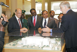 Dr Glass, Dr Gibbons, Tanzania President Jakaya Kikwete, Dr Collins and others view NIH model in clinical center lobby