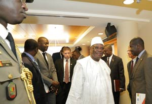 Mali President Ibrahim Boubacar Keïta and a delegation walk through halls of the NIH Clinical Center