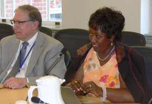 NIH Deputy Director Dr Lawrence Tabak left and Rwanda Minister of Health Dr Agnes Binagwaho right seated at conference table