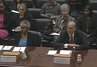 Screen capture of Dr. Marie Bernard and Dr. Roger Glass testifying before the House subcommittee