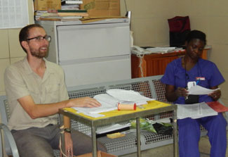 Andrew Gardner and medical worker in the hospital in Ghana