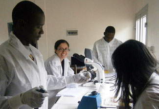 Dr. Anna Babakhanyan works with fellow researchers in the lab