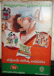 Billboard in India shows illustration of a person who has ingested poison surrounded by illustrations of other dangers of poison