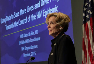 Dr Deborah Birx speaks at a podium at NIH