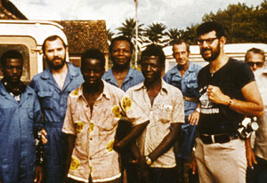 1976 archive photo showing Ebola research team in Zaire, 8 African and American researchers and medical workers pose for camera