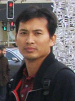 Close up of Dr. Chhorvann Chhea on a street corner in Cambodia