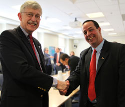 Dr. Francis S. Collins shakes hands with Dr. Jose Angel Portal Miranda on the NIH campus