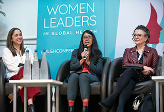 Three women participate in a panel discussion during the 2018 Women Leaders in Global Health conference.