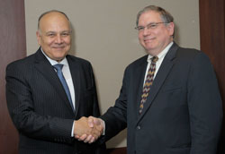 Egypt science minister Dr. Amr Salama shakes hands with NIH principal deputy director Dr. Lawrence Tabak