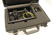 Open briefcase shows padding, wrapped up inside is wires with a fiber-optic probe
