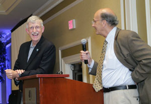 NIH Director Francis Collins and Fogarty Director Roger Glass speak at podium at fellows and scholars anniversary celebration