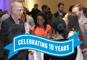NIH Director Francis Collins mingles with Fogarty fellows and scholars alumni and participants, ribbon reads celebrating 10 year
