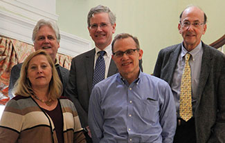 Fogarty Director Dr. Roger Glass poses with 4 new advisory board members