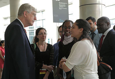 Dr. Francis Collins interacts with a few early-career scientists during a busy conference
