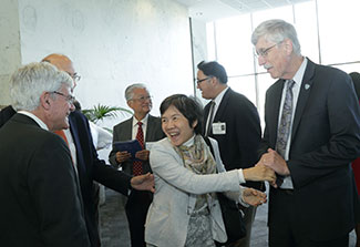 NIH Director Francis Collins greets members of the global health community during an event honoring his contributions