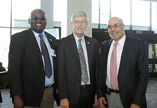 Clement Adebamowo, Francis Collins and Bill Pape pose during an event honoring the global health contributions of Collins