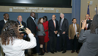 Many gather to have photos taken with NIH Director Francis Collins during an event honoring his global health contributions