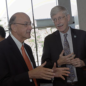 Fogarty Director Glass and NIH Director Collins talk during an event honoring the global health contributions of Collins