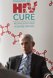 NIAID Director Dr. Anthony Fauci seated during press conference at IAS conference