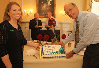 Mary Fogarty McAndrew and Fogarty Director Dr Roger Glass stand by birthday cake