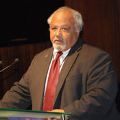 Ambassador Eric Goosby speaks at a podium