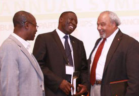 Ambassador Eric Goosby speaks with two other men at 2012 MEPI symposium