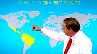 Fabio Mesquita points to section of a world map highlighted yellow (Mexico, Caribbean, north South America) labelled O Virus Da Zika Pelo Mundo