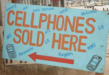 Roughly made sign reads 'Cellphones sold here'