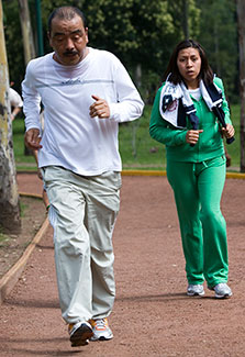Two joggers on outdoor track.