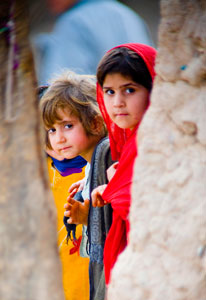 Two young Pakistani children look at camera