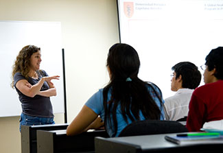 Dr. Patty Garcia lectures to a classroom of students.