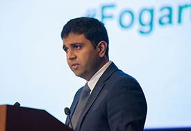 Dr. Vivek Naranbhai speaking at a podium