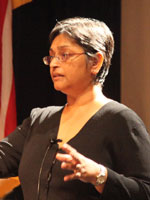 Dr. Quarraisha Abdool Karim speaks at a podium