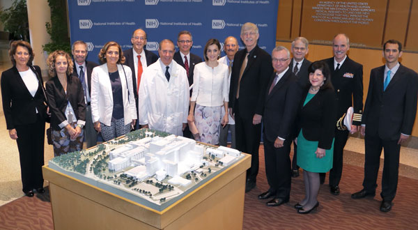 Queen Letizia of Spain and many NIH and Fogarty leaders pose for camera in lobby of NIH Clinical Center