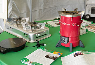 Display table with three examples of clean cookstoves