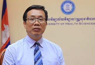 Headshot of Dr. Vonthanak Saphonn, Cambodia flag and University of Health Sciences Cambodia seal in background