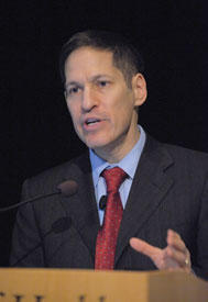 Close-up of CDC Director Dr. Thomas R. Frieden, speaking into a microphone at a podium