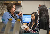 IRSDA grantee Dr Marcy Balunas trains two female researchers in a lab