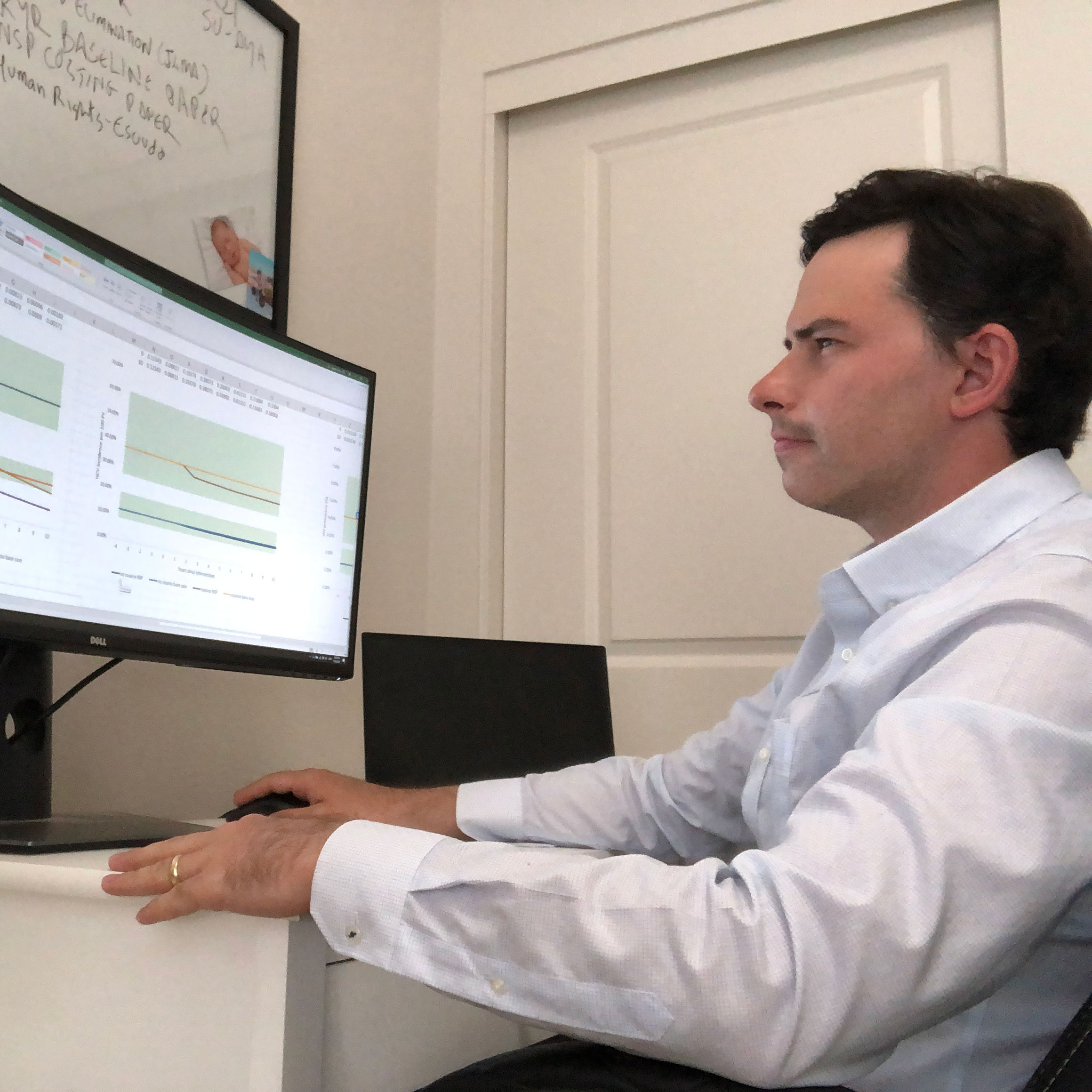 Dr Cepeda works with data on his computer screen