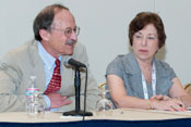 NCI Director Dr. Harold Varmus speaks at conference panel, NIEHS Director Dr. Linda Birnbaum looks on