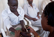 A medical worker checks the bloodpressure of a patient in a clinic