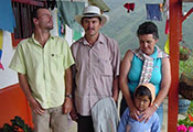 Photo courtesy of Dr. Yakeel Quiroz. A family in Colombia on the porch, mountains in background