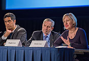 Drs. Satish Gopal, Douglas Lowy and Glenda Gray seated at panel table during the Fogarty 50th anniversary symposium