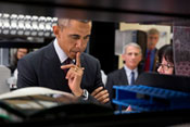 Close-up of President Barack Obama touring NIH Vaccine Research Center, listening attentively to researcher